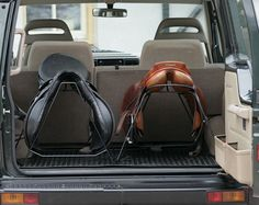 Saddle racks for the back of the car www.thewarmbloodhorse.com -brilliant! They always fall off the trailer stands