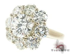 amazing diamond flower wedding ring 2.5ct. how extravagant! traxnyc.com #17284