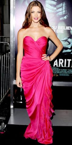 AUGUST 24, 2012  WHAT SHE WORE The actress attended the Los Angeles premiere of The Apparition in a fuchsia gown from Donna Karan Atelier accented with a knockout cocktail ring and earrings from Kimberly McDonald and nude Jimmy Choo peep-toes. WHY WE LOVE IT Va-va-va-voom! With her leg-baring draped dress, matching lipstick and Old Hollywood waves, Ashley Greene was an undeniable red-carpet bombshell.