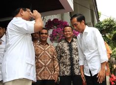 President-elect Joko Widodo (right) and Gerindra chairman Prabowo (left) salute each other during a meeting in Jakarta, Friday (17/10).