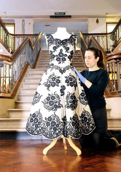 Conservator Alice Brown preparing a Constance Howarth dress for exhibition