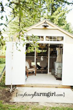 swanky chicken coop, love the galvanized feed bins, the chair for spending quality time with the chickens too.  Also love the barn light on the outside!  Windows up high give lots of light too!  Neat screen door entry into the chicken's section of the coop/shed.  ...out communing with the girls...