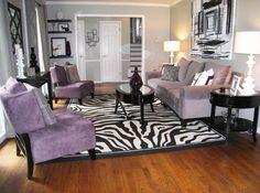 zebra print rug, accessorized shelving in the corner, colors