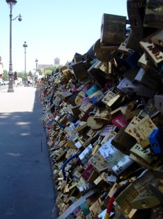 In this photo which heads down the Pont de l'Archeveche bridge in Paris you can see just how many varied love locks there are which are attached to the bridge, all varying in size, shape and colours to declare their love.  You may be interested in more; www.eutouring.com/images_pont_de_l_archeveche.html