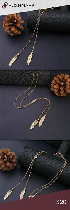 Golden Feather + Rhinestone Necklace  Gorgeous golden feathers + rhinestone necklace is perfectly understated and stunning for fall. Make a reasonable offer or take advantage of my bundle discount! Buying 3+ items? Please ask me to create a custom bundle for even greater savings!  Jewelry Necklaces