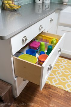 Use large pull out drawers to organize kids plates, bowls and cups so they can easily reach them.