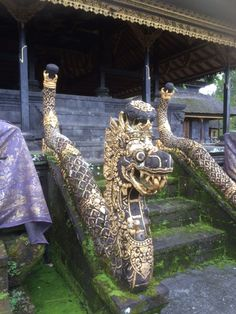 Entrance to the highest inner temple of the Besaki Temple, Gunung Agung in Bali, guarded by the sacred nagas. The nagas share all their wisdom of smoke and fire. The essence of gold!