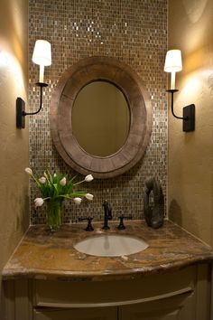 idea for 1/2 bath....in love with the back splash, mirror, and side lights