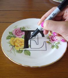 Use a Porcelaine paint pen. Cover in Porcelaine clear to act as a varnish (same baking times as colors). Dry for 4 hours. Bake at 160 for 30 minutes or as instructed.