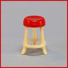 Renwal Doll House Miniature #12 Stool Cream Legs with Red Seat 1948 from curleycreekantiques on Ruby Lane