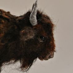 The bison is handmade by the needle felt soft sculpture technique. I created this little unique wool sculpture out of natural sheep and alpaca
