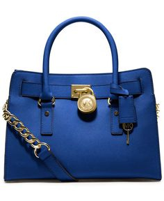 Soft leather and luxe hardware grace this gorgeous design from MICHAEL Michael Kors.