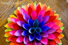 Can you imagine this gorgeous Dahlia inspired wall hanging in Christmas colors? If you want to try something other than wreaths, this paper craft is a great start.
