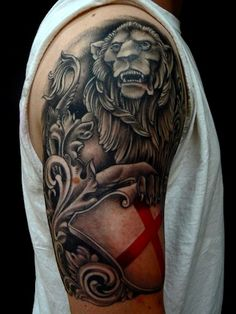 A tattoo of a lion and shield done in the spirit of English heraldry. This piece was done Honest Jon of Slave to the Needle Tattoo in Seattle, Washington. Body Art Tattoos, Tattoo Art, Tatoos, English Tattoo, Tattoo Inspiration, Tatting, Black And Grey, Lion, Tattoo Ideas