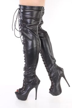 These sexy and stylish thigh high boots include a faux leather upper with a lace up tie design, back zipper closure, peep toe, leopard print soles, smooth lining, and cushioned footbed. Approximately 6 1/4 inch heels, 2 1/2 inch covered platforms, 14 1/2 inch circumference, and 23 1/2 inch shaft.