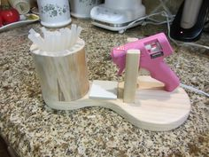 Glue Gun Holder No Mess Great for Any Crafter Unique One of a Kind by FunSurprises on Etsy https://www.etsy.com/listing/116061545/glue-gun-holder-no-mess-great-for-any