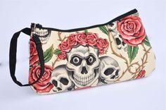 StellarCheri Skull and Roses Pleated Wristlet. $21.50, via Etsy.