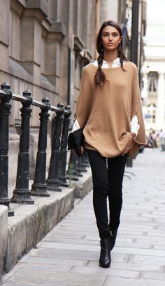 Camel cape/sweater with black skinny jeans or pants.