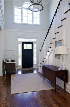Two Story Foyer Design Ideas, Pictures, Remodel, and Decor Foyer Ideas Entryway, House Design, Black Interior Doors, Foyer Design, House, Home, White Paneling, Doors Interior, Parade Of Homes