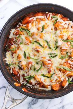 Chicken Parmesan Gnocchi Skillet is a total comfort food meal made all in one skillet. Less dishes to clean with saucy gnocchi, juicy chicken, and Parmesan and mozzarella cheeses. Top with fresh basil for serving and this gnocchi dinner will be a favorite!