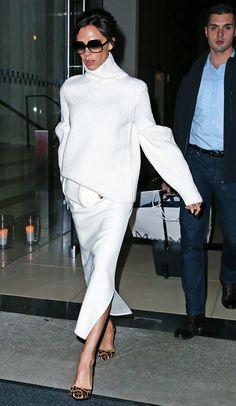 On Victoria Beckham: Cutler and Gross 0811 Sunglasses ($500) in Black; Victoria Beckham Rib Wool Bouclé Round Sleeve Jumper ($969), skirt, and clutch; Francesco Russo Calf Hair Pumps ($1015).