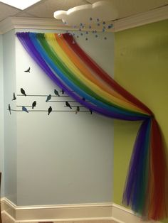 Finished tulle rainbow, birds, and foam cloud complete with raindrop crystals based on the creative gathering of the pins in my Primary Sabbath School board. Classroom decor is almost finished.
