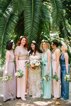 bridesmaids in jumpsuits - photo by Kallima Photography http://ruffledblog.com/70s-inspired-destination-wedding-in-the-florida-keys