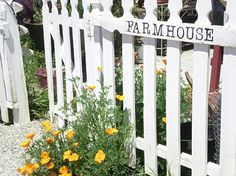 Farmhouse style picket fence with poppies