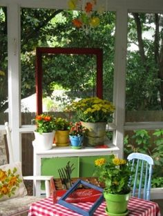 A potting bench needn't be outdoors. Dear Daisy Cottage has made her potting area decorative as well as functional, incorporating it into her screened-in porch. Colorful paint works well with brightly colored pots and a vintage bucket. Outdoor Spaces, Outdoor Living, Outdoor Decor, Outdoor Balcony, Cottage Front Porches, Screened Porches, Country Porches, Enclosed Porches, Cottage Style