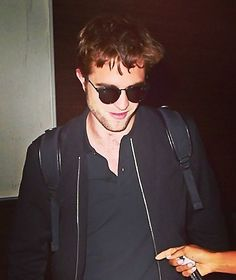 Rob at LAX on his way to London tonight, wearing his exclusive Dior shades. August 4, 2014.