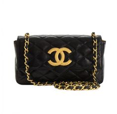 Vintage Chanel Black Mini Flap Bag with Large CC Logo. Can be used as shoulder or crossbody.