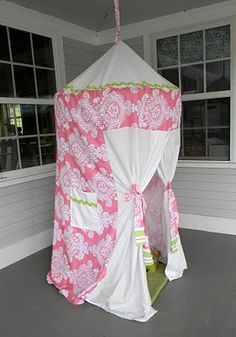Tent made with hula hoop and flat sheets. Fantastic for kids room - make a reading nook in the play room!