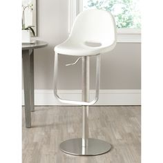 Contoured for comfort, the adjustable Andrina barstool by Safavieh marries form with function.