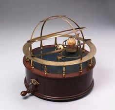 A rare and superb mechanical orrery, signed Nairne & Blunt (1774-1793).    Activated by a crank, made of mahogany and brass and housed in its original wooden box.