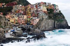 Perched high on cliffs in the National Park of the Cinque Terre is the Italian village of Manarola. The bright houses at this UNESCO World Heritage Site contrast beautifully against the Mediterranean Sea. Vacation Destinations, Vacation Trips, Dream Vacations, Oh The Places You'll Go, Places To Travel, Places To Visit, Cinque Terre Italia, Beautiful World, Beautiful Places