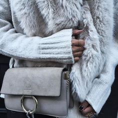 Cream colored sweater, fur vest, and Chloe Faye bag. This is the perfect get-up for fall.