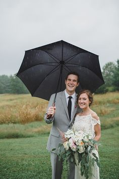 Bride and groom all smiles on their rainy wedding day! Check out the post for 12 other couples that embraced rain on their wedding day!