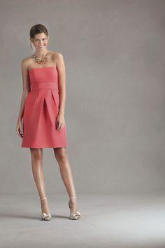 Silk Cotton slight sweetheart strapless dress. A-line skirt featuring an overlapped V-shaped pleating detail.  The skirt features hidden side seam pockets.