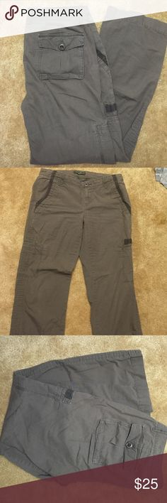 Eddie Bauer brown cargo pants size 6 boot cut Beautiful Eddie Bauer brown cargo pants, boot cut, great condition *see last picture because the only thing wrong is there a button on the right back pocket is loose and probably needs to be sewn (an easy job for someone but I have a nerve disease so I can't do it anymore)...these are really great pants very excellent condition actually Eddie Bauer Pants