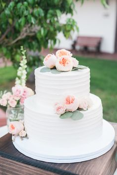 Two tier garden rose and eucalyptus topped wedding cake: Floral Design: Julep Bloom Design - http://www.stylemepretty.com/portfolio/julep-bloom-design Coordination: Agape Planning - http://www.stylemepretty.com/portfolio/agape-planning Wedding Dress: The Wedding Belle - http://www.stylemepretty.com/portfolio/the-wedding-belle   Read More on SMP: http://www.stylemepretty.com/california-weddings/2017/02/15/a-california-wedding-fueled-by-sunshine-and-love-sweet-love/