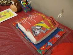 Curious George Book Cake for baby shower and Jack Johnson lullabies CD.