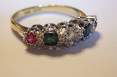 This is a really pretty antique, Edwardian multistone ring, genuine diamond, rubies and emeralds.18k yellow gold and platinum, hallmarked 18ct