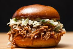 This easy recipe for pulled pork done in the slow cooker uses a simple spice mixture, onions, garlic, and chicken broth.