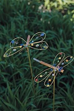 Garden art made from copper wire & beads- so simple! Use part of golf club iron for the body.