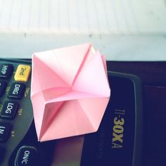"""""""Origami sits on math with the heart of Buddha"""""""