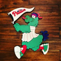 Top ten favorite mascot of all time. The Philly Phanatic running with his teams pennant. Just a few short weeks away from the first pitch DM me if interested in anything Ive posted or something I havent done yet #phillies #mlb #baseball #philadelphiaphillies #woodworking #woodensign #chapelcreekcustoms