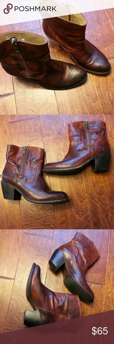 """Frye Leslie Ankle Boots Sold out online. Boots are broken in with lots of life still left. From website:  DESCRIPTION  Rich dyes and hand burnishing lend Leslie, at bootie height, a soft but deep finish. Hard wearing, foundry forged zip runs to a gently sloping collar. Nicely lifted by stacked leather heel. FEATURES  - Vintage Veg Tan leather upper - Leather lined - Leather outsole with rubber forepart - Goodyear welt construction   Size and Fit - 6 1/2"""" shaft height - 12 1/4"""" shaft…"""