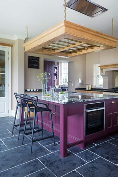 hand made transitional kitchen with hand painted kitchen island in purple and grey marble top stainless steel appliances ceiling hung wooden pot black ceramic floors black stools of 50 Inspiring Purple Theme Colour for Kitchen Purple Kitchen Cabinets, Painted Kitchen Island, Kitchen Colors, Kitchen Design, Kitchen Flooring Options, Best Flooring For Kitchen, Flooring Ideas, Vaulted Ceiling Kitchen, Kitchen Photos