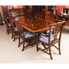 A beautiful dining set which comprises a flame mahogany twin pillar dining table and a matching set of eight chairs. Buy Dining Table, Dining Set, Dining Chairs, Chair Height, Table And Chair Sets, Furniture Collection, Furniture Making, Side Chairs, Matching Set