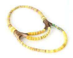 """Yellow Three Bows"" by Silke Spitzer, 2014. Dearhead, plastic, fabric, wood."